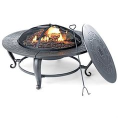 """Four Seasons Courtyard, 35"""", Round Wood Burning Fire Pit, Decorative Stamped Tabletop & Cast Legs, Porcelain Coated Firebowl With Mesh Screen Cover, Center Cover Insert Included To Create A Table When Firepit Is Not In Use, Includes Poker."""