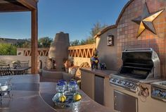 Traditional Patio with exterior brick floors, Outdoor kitchen, Fence