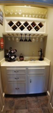 This little wet bar is tucked away in a hidden closet, just off the living room!