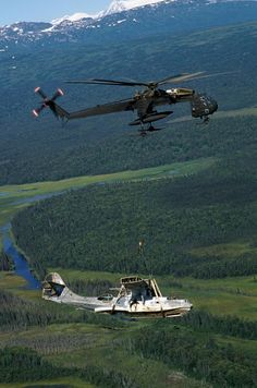 """aviationandships: """" An Alaska Army National Guard Sikorsky CH-54B Tahre airlifts…"""