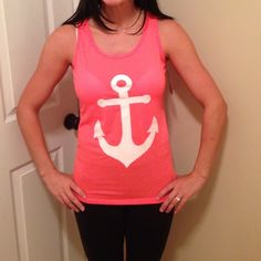 Anchor bow back tank Bright coral color with white anchor in front, and tiffany blue bow in back. Reposhing seller said its a med fits more like a xs/s. Less on Ⓜ️ Tops Tank Tops