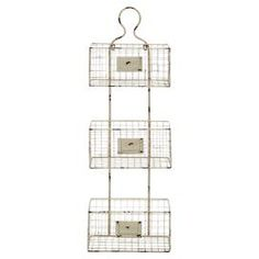 """Showcasing 3 wire baskets and a distressed white finish, this hanging wall rack is perfect for stowing scarves and hats in the entryway or spices in the kitchen.  Product: Wall rackConstruction Material: IronColor: Distressed whiteFeatures:  Three tiersFront slot for labeling Dimensions: 36.5"""" H x 12.5"""" W x 3.5"""" D"""