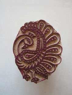 Intricately carved raw wood block stamp found on Etsy