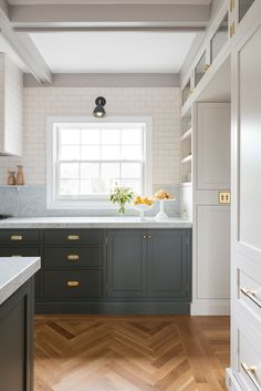 Wood herringbone floors will forever be a favorite. Amazing design by Box Street Design #greykitchens