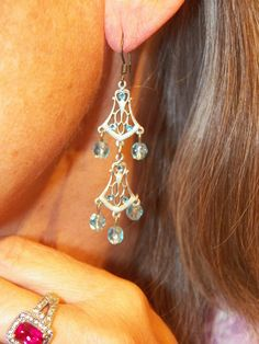 Double tier blue crystals with intricate design. Find these and other unique earrings at The Prince's Table!