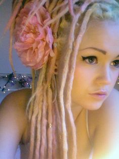 Pink and blonde dreads  I normally hate dreadlocks on anyone but African American woman but this is an exception, she's really cute.