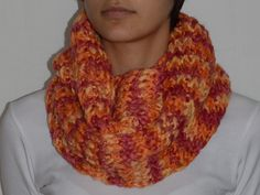 Loom knitted infinite scarf in pink and orange melange with shiny thread, made of merino wool / polyester yarn, the perfect Christmas gift