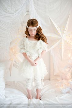 White Christmas photo shoot. Like the all white, but kid too serious.