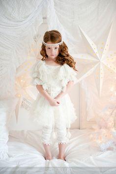 White Christmas photo shoot. Like the all white, but kid too serious.