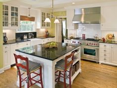 Black granite countertops, white cabinets, green walls, wood floors, red accents . . .