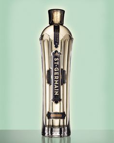 """""""Paris in a bottle"""" as creative direction, combining Art Nouveau imagery with a """"Frenglish"""" voice - St-Germain (elderflower liqueur) bottle packaging and label - designed by Sandstrom Partners"""
