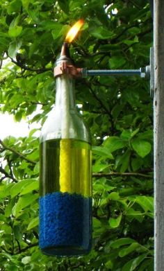 Wine Bottle Crafts Tiki Torch - I have but never thought of filling the bottom with rocks.  Clever!