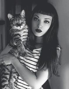can't decide what i like best between the hair, the makeup, and the kitty.