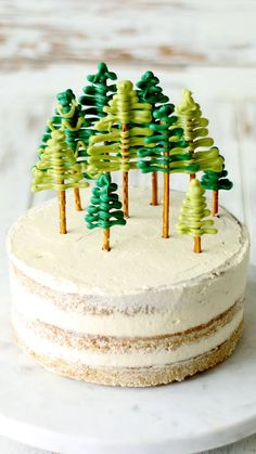 Moist gingerbread vanilla cake covered in fluffy coconut buttercream frosting and chocolate pretzel trees on top.