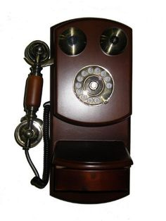ORE International Classic Style Wood Wall Telephone by ORE. $81.53. Redial button. Handsfree operation. Classic style telephone in gold and wood finish. Pulse/tone switch. The nostalgic look of this wall phone is a reproduction of the charming heritage of yesteryear with modern electronics and features. The cherry color wood and veneer construction is accented by the brushed brass handle and hardware. Handy writing shelf is ideal for jotting down important not...