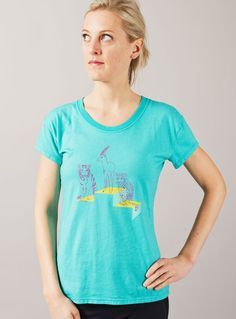 "Oiselle's podium tee: ""In a world dominated by men, women are now performing too. The two felines symbolize the speed and strength. You expect they'd finish 1st. But the delicate gazelle is on top of the podium. For me, it's a way to show that determination can lead you to the top, even if the odds are against you. A little bit like David against Golliath."""