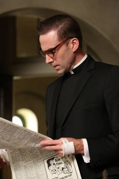 Joseph Fiennes as Monsignor Timothy Howard in American Horror Story Asylum  I know it's wrong but the cleric robes really get me here. Like Joaquin Phoenix in Quills. Guh!