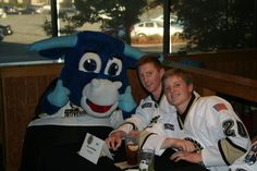 William Messa and Mike Brodzinski pose for picture with Ollie at the Lumberjacks Meet and Greet at Buffalo Wild Wings on Wednesday, Sept. 26, 2012 #USHL