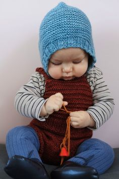 Cutie Patootie - oh and the bonnet is cute too.   Blue knitted bonnet - Misha & Puff - Ledansla
