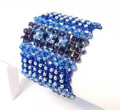 Bead weaving tutorials - links on bottom of page or to the left.