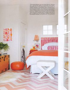 Painted wood floors, clean bright bedroom - love the orange chest- Beach house designed by Mona Ross Berman.