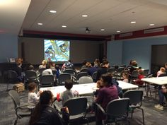 https://flic.kr/p/BfvWbn   Friday Flicks & Fun Nov. 2015   Families get together to watch picture book films on the big screen and work on crafts with young ones.  November 2015.