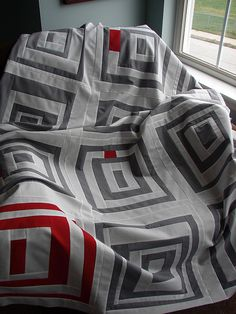 Lovely neutrals with little pops of red. Quilt by Jacquie of Tall Grass Priarie Studio.