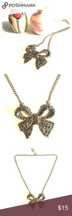 🎀Limited🎀 Statement Bow Necklace 🎀Limited🎀 Statement Bow Necklace. Add a bit of girly glam to any outfit! All gemstones in tact. The Limited Jewelry Necklaces
