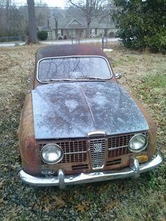 A rusting Saab located in Harrison Arkansas. Tripper's Travels.