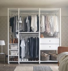 IKEA ELVARLI storage systemAlt text: A white open storage with clothes rails, shelves and drawers.