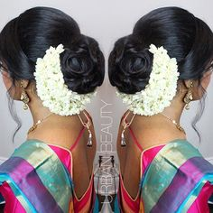 What a beautiful braided low bun with real flower gajra! Care however should be taken before adopting such hairstyles, as due to it's high static charge, it will cause phlegm to move up in the throat, causing the voice to quaver & a frequent urge to clear the throat. A heavy chabi chhalla with a long & wide hook if inserted at the edge of the pleats of the saree, will reduce this problem as it's hook will activate the acupressure points that act to keep the throat clear.
