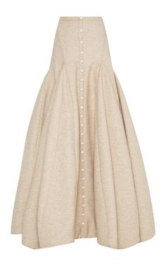 This **Rosie Assoulin** skirt features a dropped waist with an exaggerated flare and buttons along the front.