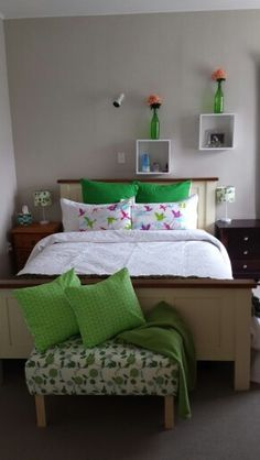 I love the green theme for a bedroom