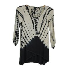 A black cream dye mock wrap tunic from Luna West. The top comes with a wrap style that reflects a trendy touch. With roll up sleeves, this versatile piece can be teamed with matching pants or jeans and shoes for a perfect summery look.