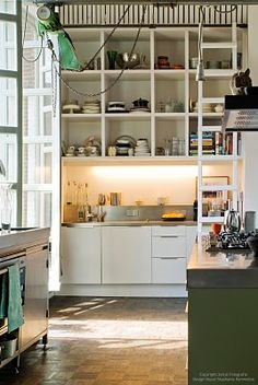 drawn to the combo of white, khaki/moss green, black and wood or stainless in a kitchen lately