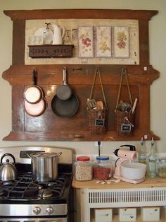 great idea: box as shelf, baskets hanging for utensils. (could use binocular case I have)