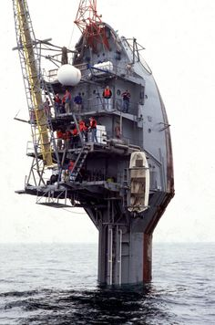 The RP FLIP is a 355 feet (108 meters) long vessel designed to partially flood and pitch backward 90 degrees, resulting in only the front 55 feet (17 meters) of the vessel pointing up out of the water, with bulkheads becoming decks. This makes the ship mostly immune to wave action. It is frequently mistaken for a capsized ocean transport ship.#Repin By:Pinterest++ for iPad#