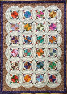 "Anything But Boring -   Circle Stars. This quilt is a third generation design. In 1871 Elizabeth Mathews Baxter created a beautiful and original wedding quilt for her son and his wife. Mary Ann Keathley was entranced by a photograph of this antique quilt and in 1989 created ""Hidden Circles"" based on that original quilt. Mary's quilt can be found in the Leisure Arts Book, Encyclopedia of Classic Quilt Patterns, published by Oxmoor House. Janice removed several of the curves and adapted the…"
