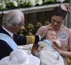 Three generations: Princess Estelle with her mother, Crown Princess, and grandfather, the King of Sweden.