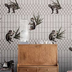 The whimsical pattern of this grey and off-white wallpaper features the image of a monkey in two different poses, which are repeated on alternating rows,. Monkey Wallpaper, White Wallpaper, Bathroom Wallpaper, Elements And Principles, Interior Architecture, Interior Design, Repeating Patterns, Monkeys, Pattern Wallpaper