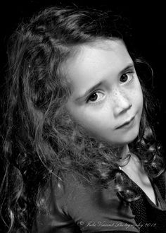 Maeve. Studio photography, children. This little tyker rarely looks sad. I asked her to make a sad face. Reminds me of the little match girl.