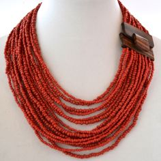 Hand craved wood buckle necklace with cascading seed beads. INC74 Antique Red from the Beaded Soul