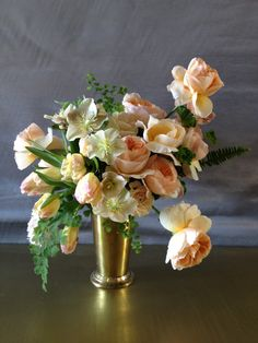 Amazing garden roses and hellebores in a brass julep cup by Spruce Foral