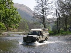 Series 2 Land Rover Defender fording a river.