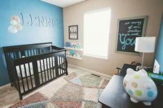 #Blue and #tan pair so well in this simple, #modern #nursery.