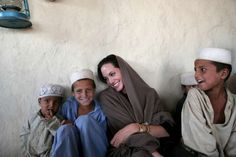 Jalalabad, Afghanistan - October 22: UNHCR (United Nations High Commissioner for Refugees) Goodwill Ambassador Angelina Jolie is seen during her visit to Afghan returnees from the recently closed Jalozai camp in Lower Sheikh Mesri in Jalalabad on October 2008. © Marco Di Lauro/Getty Images