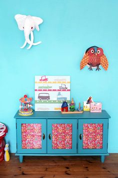 Old is new again: An old cupboard is transformed with paint and patterned paper! #diy #kidsrooms #vintage
