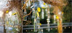 Delicate flowers hanging from a rustic arbor. Photo by Archetype Studio