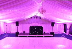 All white dance floor in a marquee with colour changing LED uplights giving this gorgeous pinky purple colour! Black star cloth DJ booth and HK Audio speakers White Lead, All White, Light Up Dance Floor, Led Dance, Dance Floors, Dj Booth, Audio Speakers, Black Star, Colour Black