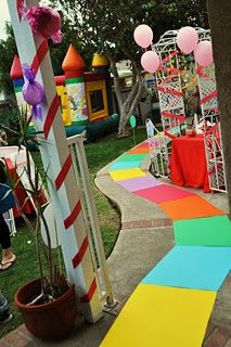 candyland party with a bounce house...fun and cheap idea with streamers, balloons and construction paper
